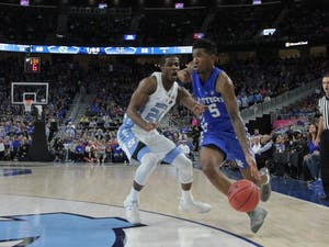 UNC guard Kenny Williams (24) defends Kentucky freshman guard Malik Monk (5) as he drives to the basket at the CBS Sports Classicon Saturday.