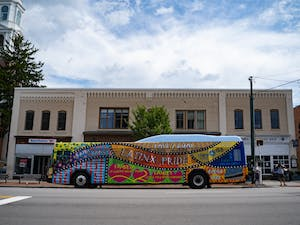 The Latinx Pride bus at a bus stop on Franklin Street on Tuesday, Aug. 18, 2020.