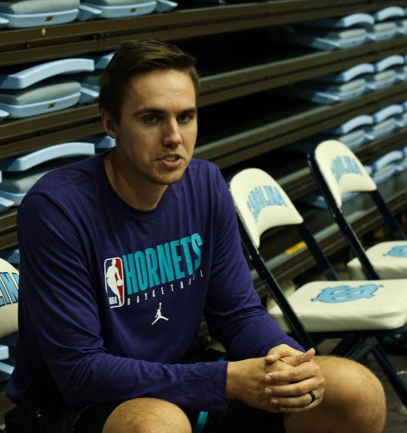 Former UNC forward and current Charlotte Hornets assistant video coordinator Jackson Simmons, pictured on Friday, Oct. 4, 2019, returned to the Smith Center for Hornets training camp last week.