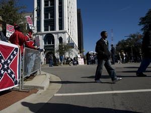 Supporters of the Confederate Flag that flies in front of the state Capitol in Columbia, South Carolina, line up on Gervais Street during the King Day at the Dome celebration on Monday, January 21, 2008, in Columbia, South Carolina. (Robert Willett/Raleigh News & Observer/MCT)