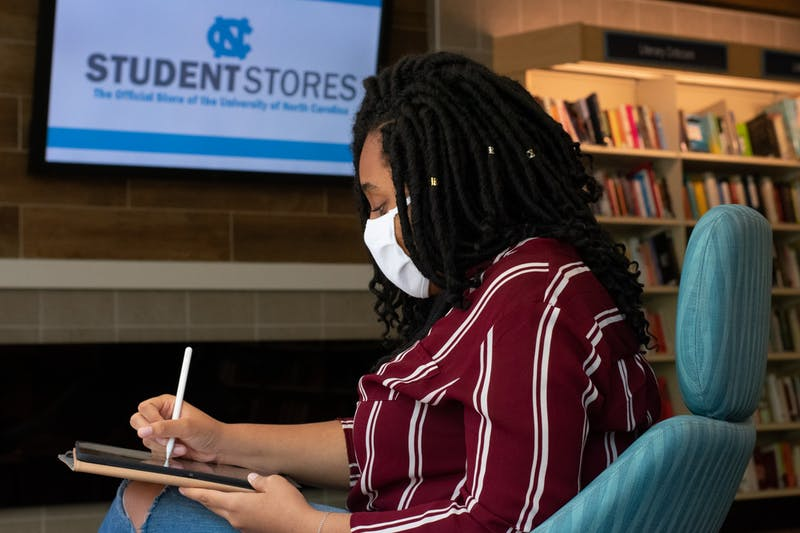 UNC philosophy sophmore Jessica Uba spends time outside her dorm studying on the third floor of student stores on Sunday, Sept. 6, 2020.