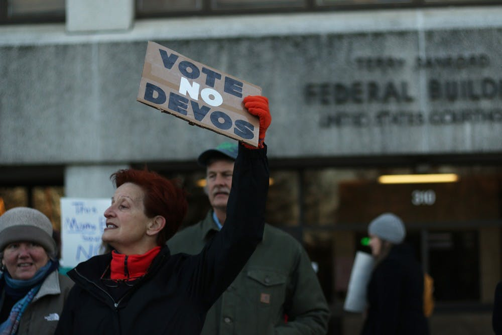 Michele Cox from Newton Grove, NC stands in front of the Federal Courthouse Building to ask Senator Tillis to vote no to Betsy DeVos.
