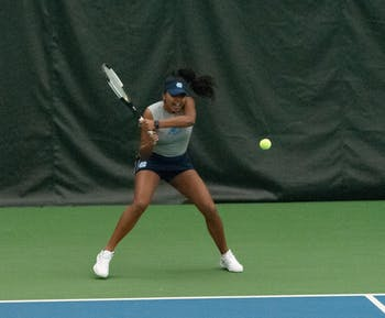 UNC first-year Anika Yarlagadda returns a serve from her ECU opponent. UNC won against ECU on Saturday, Feb. 15, 2020 in the Cone-Kenfield Tennis Center. The UNC women's tennis team is the 2020 ITA Champion and remains undefeated this season.