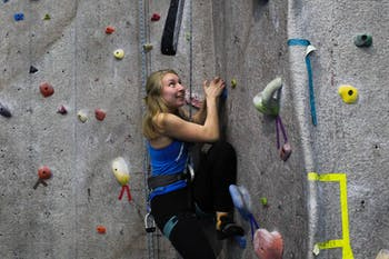 "Anna Baechtold, a first-year art history major, practices rock climbing during practice on Thursday, Feb. 27, 2020 at Fetzer Gym C. ""It's so literal and so easy to see your progress where in other sports, it's a bit more arbitrary,"" she said."