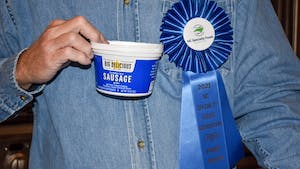 """Jim Millican of Big Delicious Brand, Inc. poses in his home in Raleigh on Oct. 9. Millican says his product, which won 1st place in the Deli/Dairy category, is """"much more than a dip""""."""