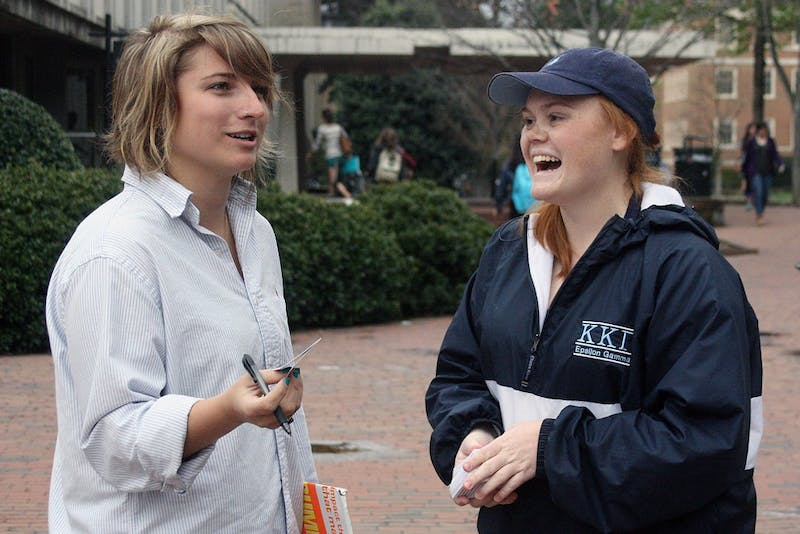 "Kathryn Walker a junior Poli Sci andPR major with a history minor talks to Liz Kazal from Environment NC .Student government is partnering with different group on campus so student have and opportunity to vote in the primary for NC. ""We think that its really important theta students who want to vote have the opportunity to do so."" --Wilson Parker"