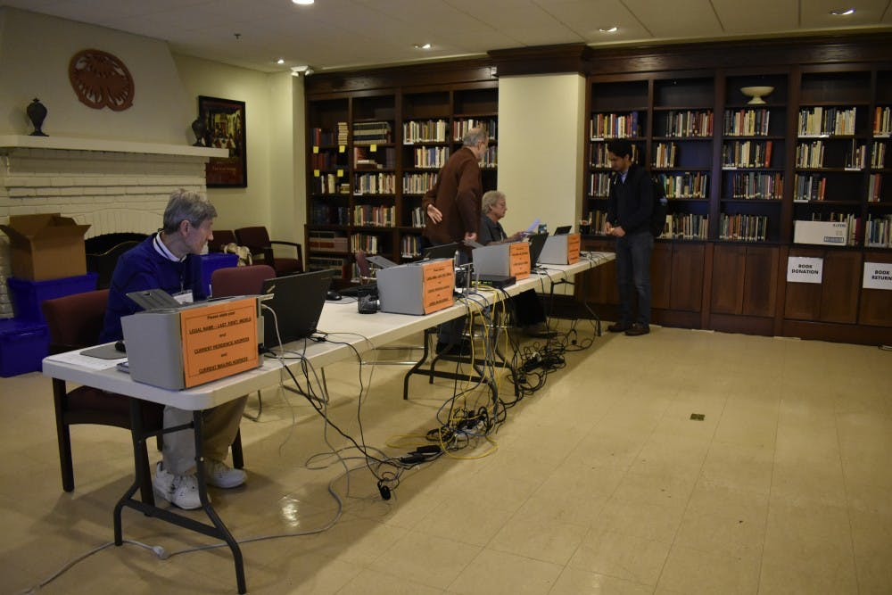 <p>Volunteers prepare for voters at Chapel of the Cross, an early voting and Election Day voting location used by many UNC students.</p>