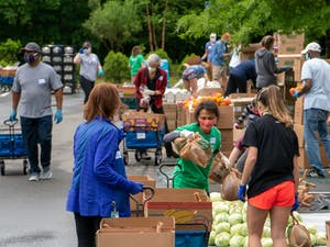 Volunteers help with food distribution at Chapel Hill Public Library on Friday, May 22, 2020. Photo courtesy of Tom Simon.