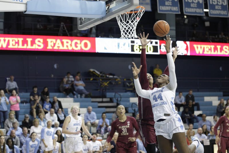 UNC Center Janelle Bailey (44) dodges FSU players during a game in Carmichael Arena on Sunday, Jan. 6, 2019. UNC lost 63-64.