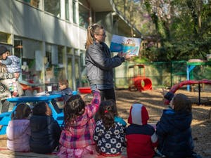 Eppie Landis (Center), a blue room teacher, reads for students at the Chapel Hill Cooperative Preschool on Monday, April 1st. The Cooperative Preschool system also finalized plans to consolidate their two Chapel Hill sites into a single facility on Monday, April 1, 2019.