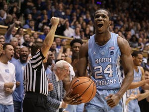 Guard Kenny Williams (24) celebrates after drawing an offensive foul against Duke on March 3 in Cameron Indoor Stadium.