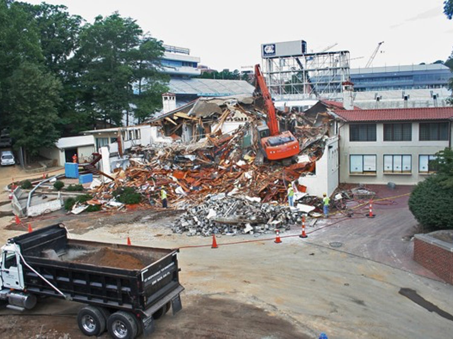 Demolition crews tear down the Kenan Fieldhouse on June 8. DTH/Robert Turner Story