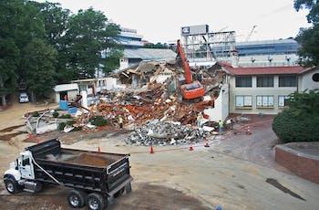 Demolition crews tear down the Kenan Fieldhouse on June 8. DTH/Robert Turner Story