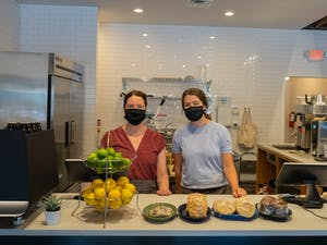 Perennial baristas Michelle Temple (left) and Grace Stroup (right) pictured on re-opening day, Friday, May 28th, 2021.