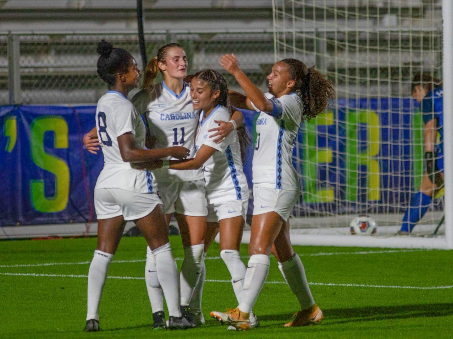Members of UNC's women's soccer team celebrate their first goal, scored by junior midfielder Brianna Pinto (8), during the first round of the ACC tournament against Virginia Tech on Tuesday, Nov. 10, 2020 at WakeMed Soccer Park. UNC beat Virginia Tech 1-0, with Pinto's goal being the only of the night.