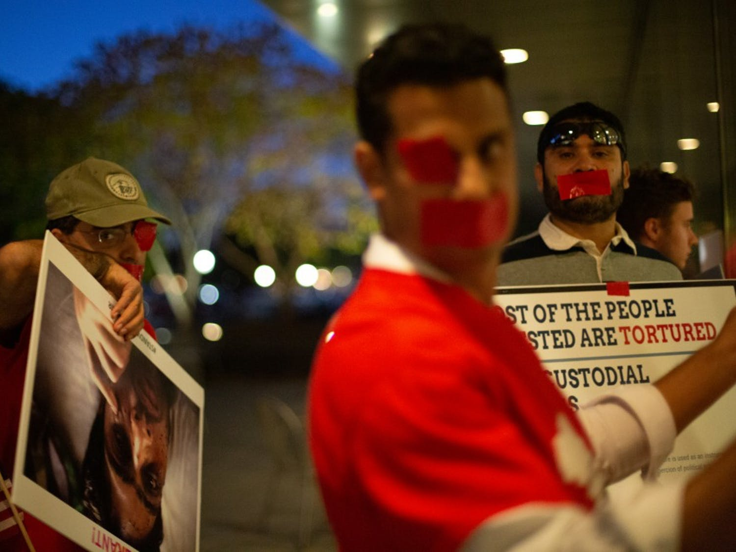 """Pro-Kashmiri demonstrators, who declined to be identified, gather outside the Global Education Center to protest the arrival of Harsh Vardhan Shringla, the ambassador from India to the United States, at the invitation of the Krasno Event Series on Friday, Oct. 10, 2019. The group accuses India of perpetrating human rights abuses against the """"semi-autonomous"""" region of Kashmir. """"I think this event is a political event, which Indian ambassador is trying to project lies inside about their atrocities in Kashmir and talking of India as a trade partner and asking U.S. to do a strategic partnership,"""" one protestor says."""