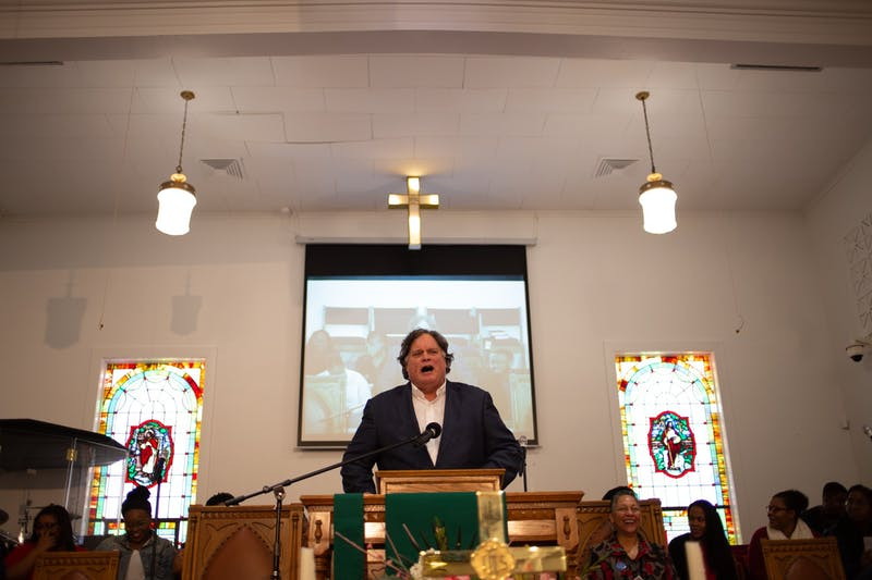 "Gene Nichol, a UNC law professor, addresses a crowd of community members in the sanctuary of First Baptist Church on Monday, Jan. 20, 2020. ""We are required to stand: everyone in this community, every member of this state, Republican, Democrat, White, Black, Latino, every member of this rainbow,"" Nichol said. ""We're required to stand because somewhere we read 'we hold these truths to be self-evident, that all men are created equal,"" he said."