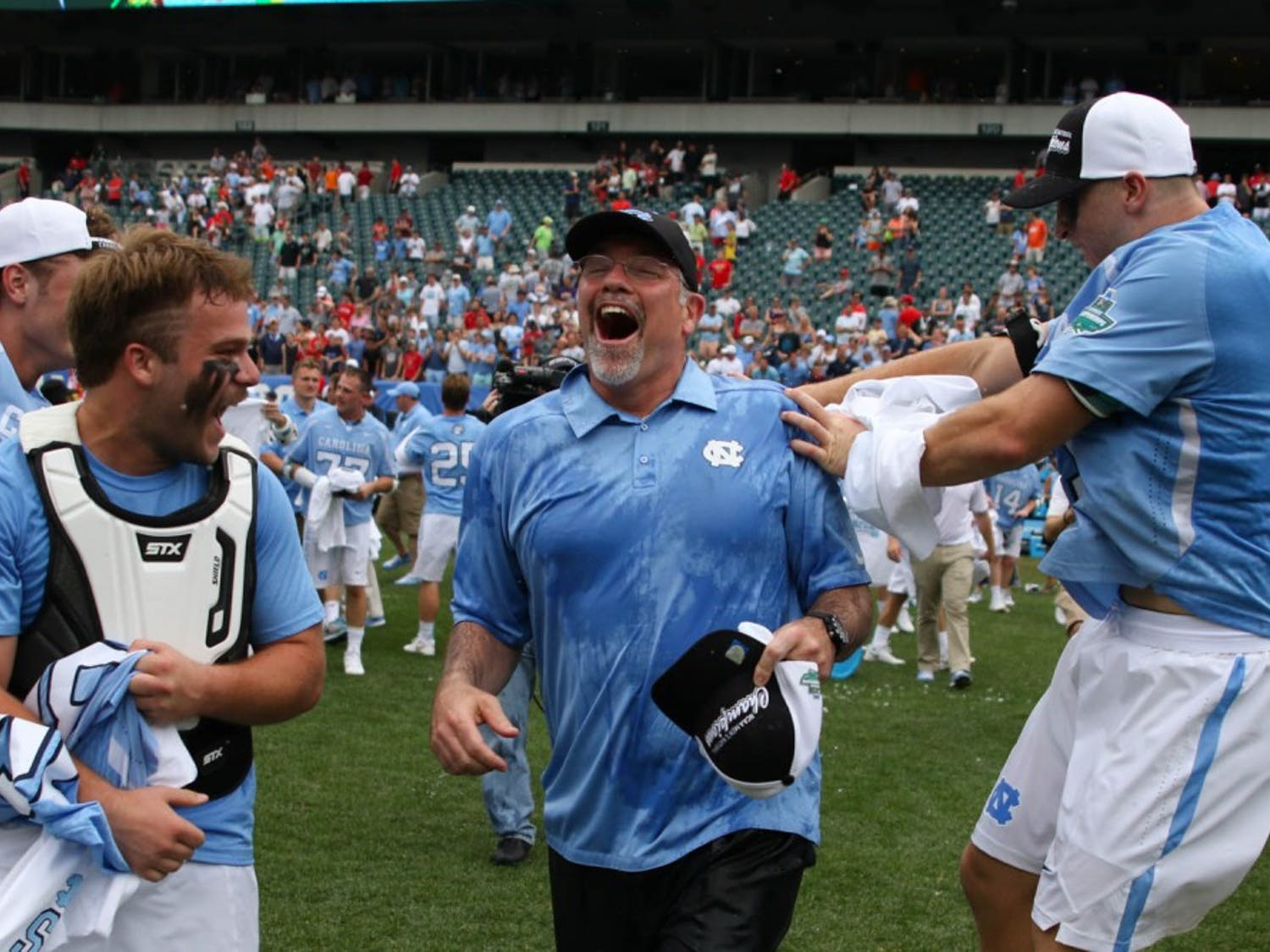 UNC men's lacrosse coach Joe Breschi runs towards his players after being given a gatorade bath.The unseeded North Carolina men's lacrosse team defeated No. 1 Maryland 14-13 in overtime to claim the program's first national championship since 1993 on Monday at Lincoln Financial Field in Philadelphia.