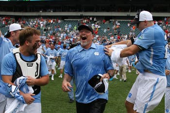 UNC men's lacrosse coach Joe Breschi runs towards his players after being given a gatorade bath. The unseeded North Carolina men's lacrosse team defeated No. 1 Maryland 14-13 in overtime to claim the program's first national championship since 1993 on Monday at Lincoln Financial Field in Philadelphia.