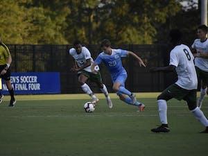 UNC junior midfielder Jeremy Kelly (29) dribbles the ball in his team's 2-0 win over Jacksonville on Sept. 3 at Koskinen Stadium.
