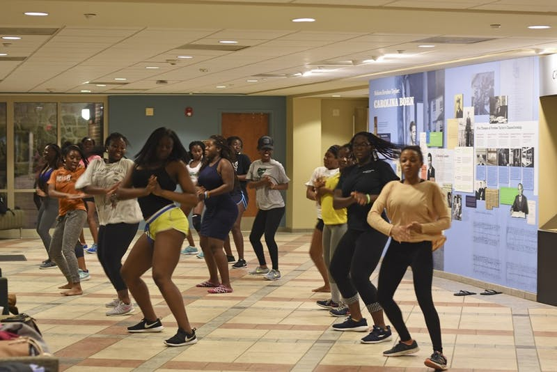 Dancers rehearse for last February's Battle of the Schools African Dance Competition, also hosted by OASIS.