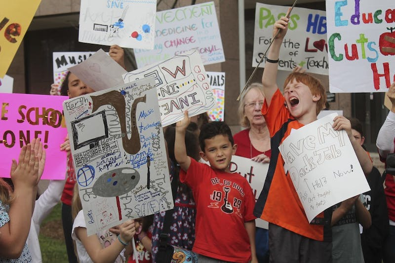 Public school children exhort passing the HB13 bill during a protest in Raleigh