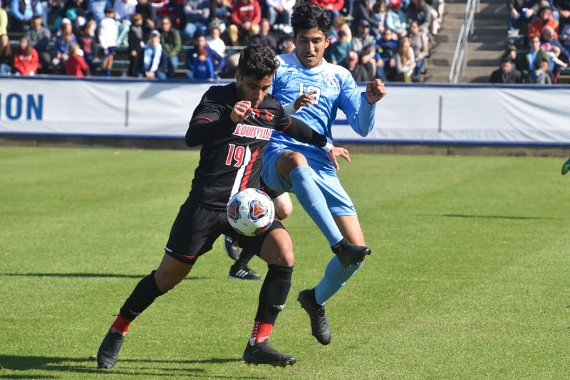 UNC junior Martin Salas (19) and Louisville freshman Pedro Fonseca (19) fight for the ball in the ACC championship game on Sunday, Nov. 11, 2018 at WakeMed Soccer Park. UNC lost to Louisville 0-1.
