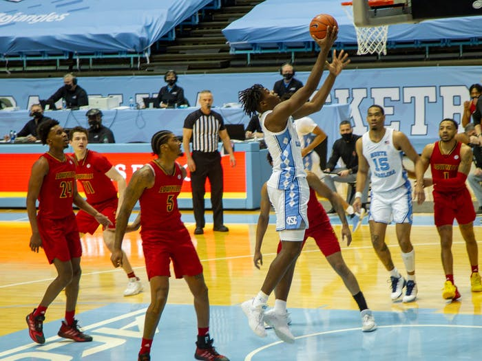UNC Freshman Forward Day'Ron Sharpe (11) shoots a basket at the game against Louisville on Saturday Feb. 20 2021 at the Dean Smith Center in Chapel Hill.