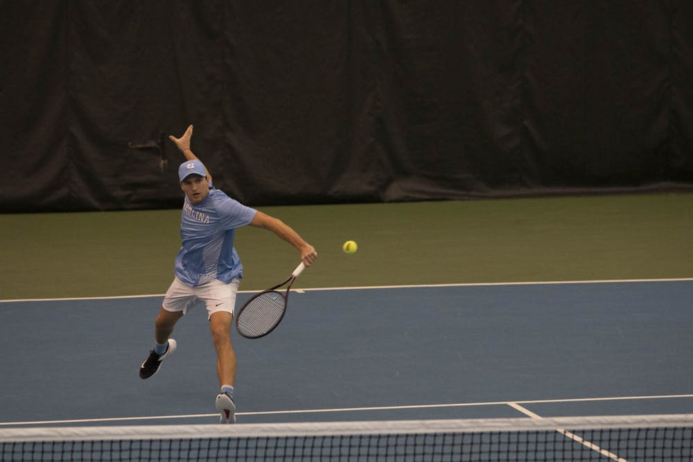 <p>UNC sophomore Brian Cernoch hits the ball during a singles match against Illinois on Saturday, Feb. 1, 2020 at the Cone-Kenfield Tennis Center. UNC beat Illinois 4-0.</p>