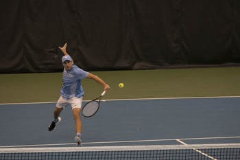 UNC sophomore Brian Cernoch hits the ball during a singles match against Illinois on Saturday, Feb. 1, 2020 at the Cone-Kenfield Tennis Center. UNC beat Illinois 4-0.