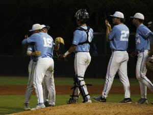 UNC baseball players celebrate after winning the final game of the regional championship. UNC beat Tennessee 5-2.