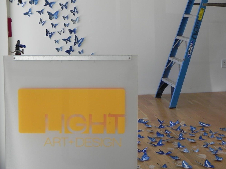 Constructing thebutterfly installation atLight Art   Design