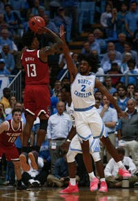 UNC first-year guard Coby White (2) attempts to block N.C. State redshirt junior guard C.J. Bryce (13) from scoring in the Smith Center on Tuesday, Feb. 5, 2019. UNC won 113-96. White scored 21 points during 27 minutes of play time.