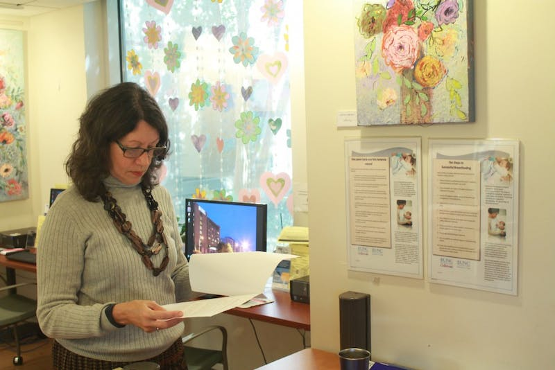 Health Education Director of the Women's Health Information Center Mary Quezada looks over paperwork for the UNC Women's Health Center on Monday, Oct. 22.