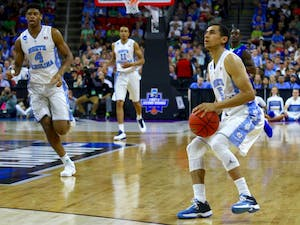 Marcus Paige winds up for a three-point shot.