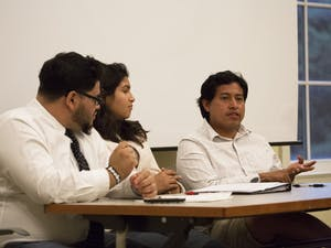 Carolina Hispanic Association (CHipsA) panelists Manny Amaya, left, Cecilia Polanco, and Emilio Vicente speak to members of the UNC-Chapel Hill chapter of the NAACP in the Upendo Lounge at SASB North.