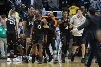Miami guard Ja'quan Newton (0) celebrates with his team after hitting a game-winning 3-pointer against UNC on senior night on Feb. 27 at the Smith Center.