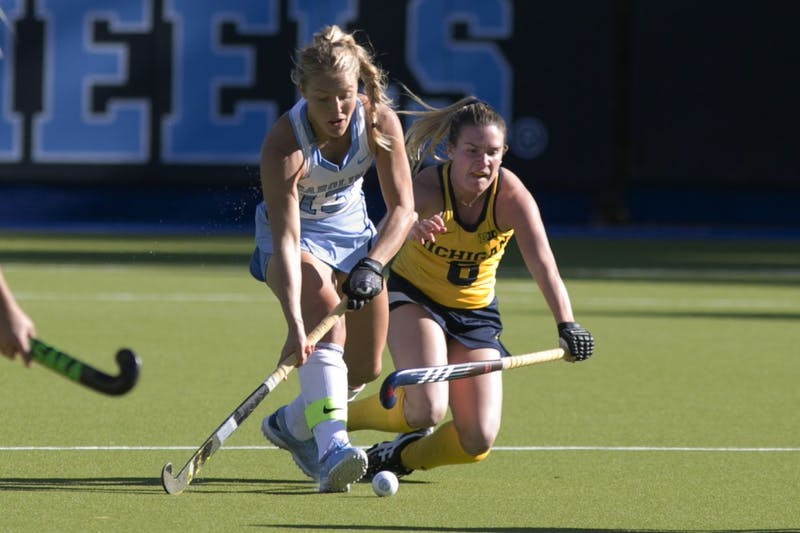 Senior midfielder Ashley Hoffman (13) compete for the ball against Michigan forward Tina D'Anjolell (6) during the second round of the NCAA Tournament Sunday, Nov. 11, 2018 in Karen Shelton Stadium. UNC won 5-2 to advance to the final four.