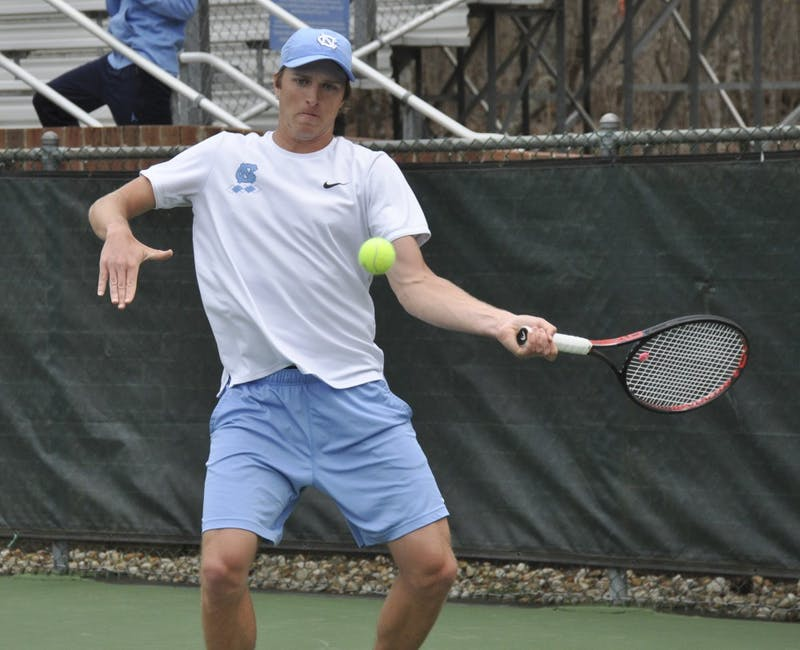 First-year Brian Cernoch hits a forehand during UNC's match against Florida State on Sunday, March 31, 2019. The Heels beat the Seminoles 6-1.