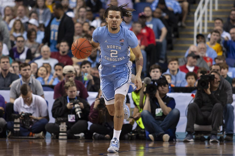 <p>First-year guard Cole Anthony (2) dribbles during the first-round of the ACC tournament against Virginia Tech in the Greensboro Coliseum Complex on Tuesday, March 10, 2020. UNC beat Virginia Tech 78-56.</p>