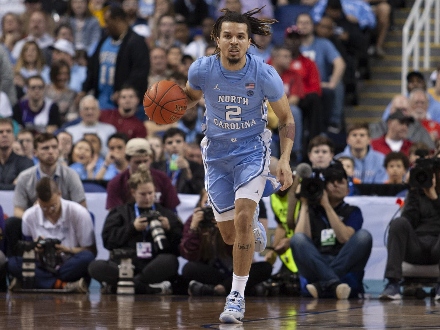 First-year guard Cole Anthony (2) dribbles during the first-round of the ACC tournament against Virginia Tech in the Greensboro Coliseum Complex on Tuesday, March 10, 2020. UNC beat Virginia Tech 78-56.