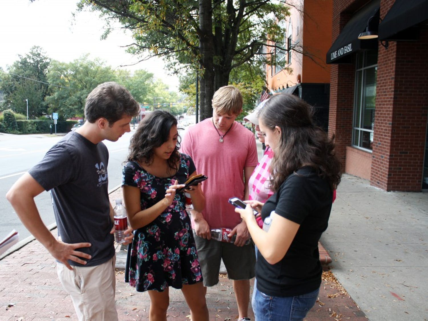 """Team """"Holding On (To The Glory Days)"""" assembles to come up with their strategy to win Love Chapel Hill's annual scavenger hunt on Saturday afternoon."""