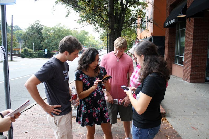 "Team ""Holding On (To The Glory Days)"" assembles to come up with their strategy to win Love Chapel Hill's annual scavenger hunt on Saturday afternoon."