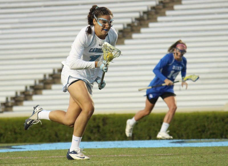 Women's lacrosse suffers a loss 7-6 to Duke in overtime on Wednesday in Kenan Stadium. No. 9 Margaret Corzel sprints downfield during the second half.