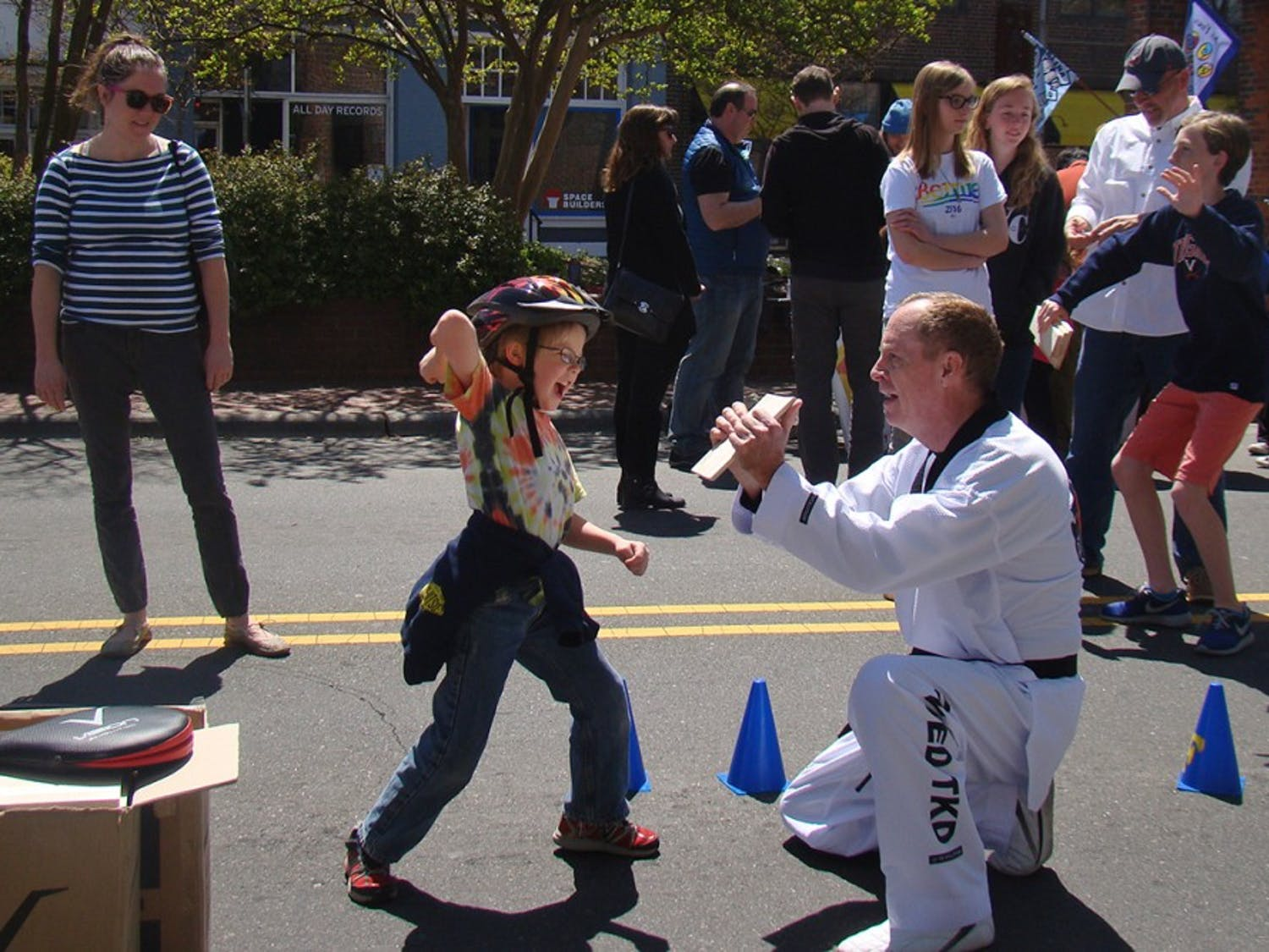 Elliot (8), of Carrboro, breaks a board as one of the many activities at Carrboro Open Streets festival on Sunday April 10th, on Weaver St.