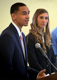 Student athlete Marcus Paige answers a question during the meeting of the Board of Trustees 3/27 at the University of North Carolina at Chapel Hill.  In background are Lori Spingola and Kemmi Pettway.