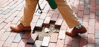 D'Angelo Gatewood, a chemistry and public relations double major, crosses a patch of missing bricks on his way to an Admissions Ambassadors interview.