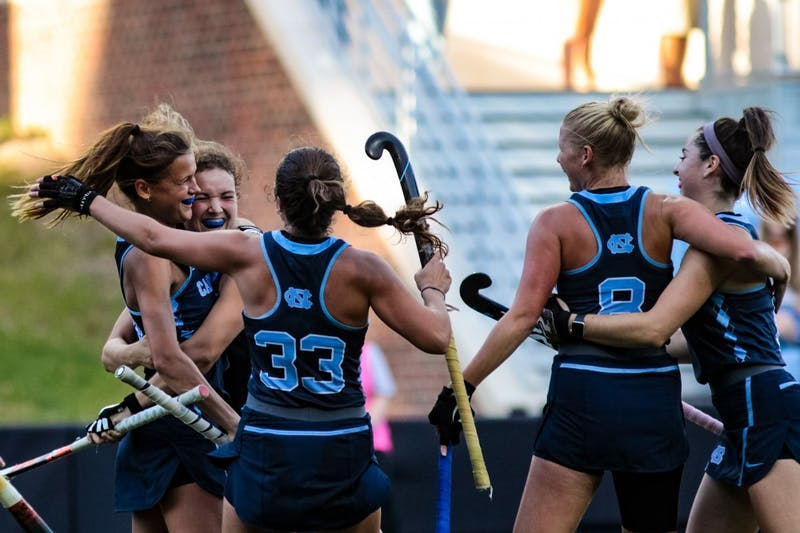 UNC junior midfielder Eva Smolenaars (21), embraces senior midfielder Yentl Leemans (18). Senior forward Marissa Creatore(33), senior forward Catherine Hayden (8) and sophomore forward Erin Matson (1) join the group hug. UNC beat Louisville 4-1. This marked their 29th consecutive victory.