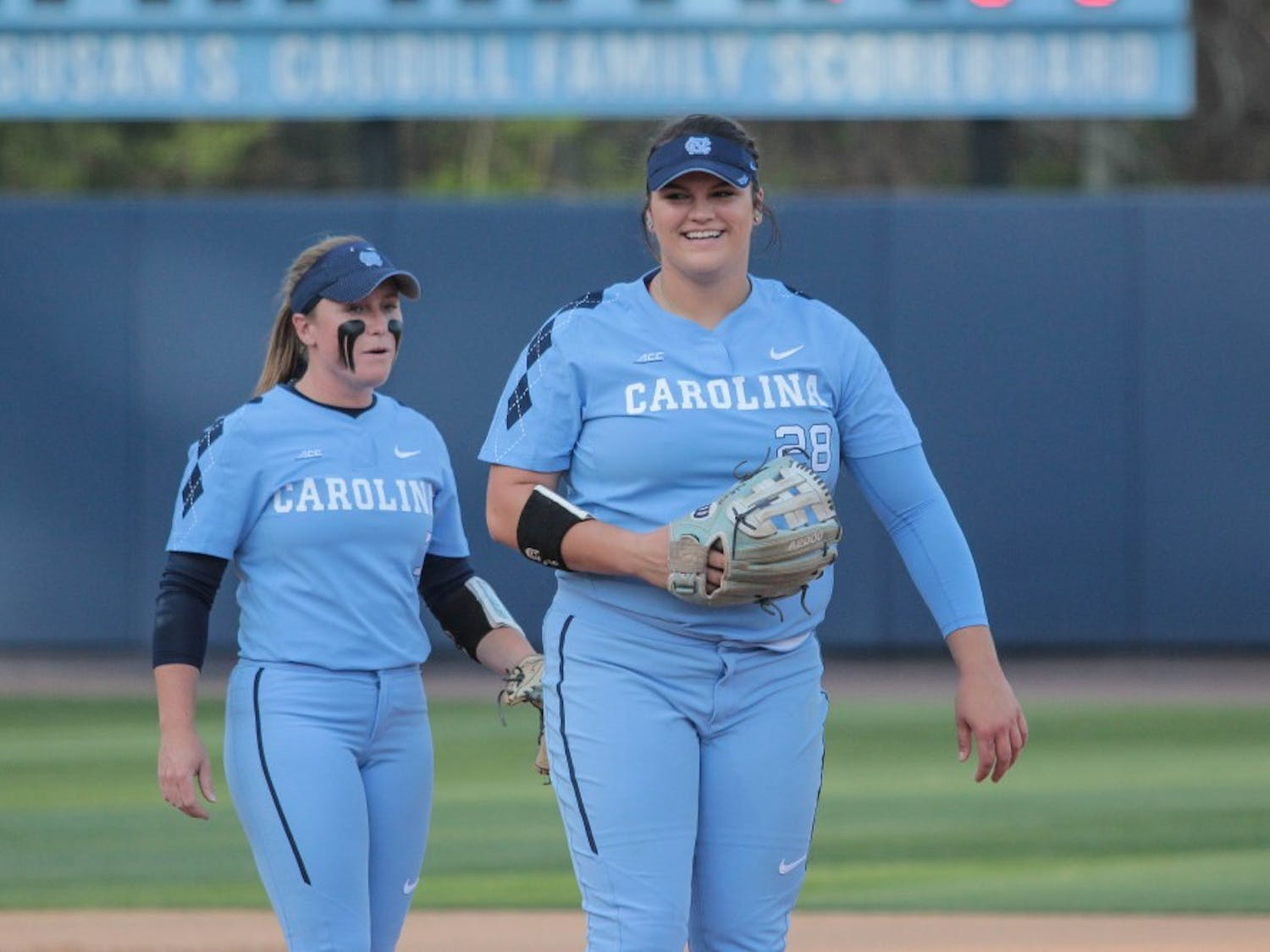 Senior Taylor Wike (7) and sophomore Brittany Pickett (28) joke during a game against N.C. State on April 13 at Anderson Stadium.