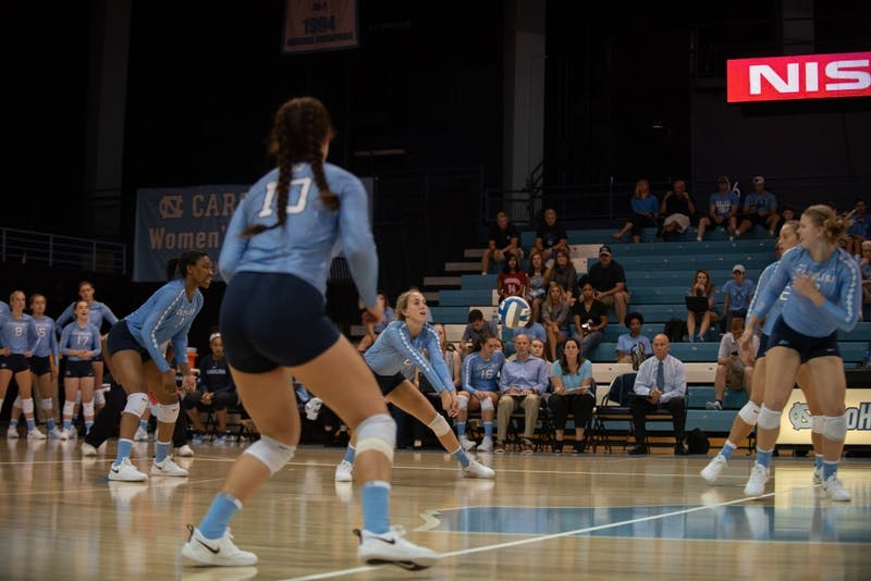 Hunter Atherton (10) looks on during a Greer Moseman dig against Michigan State on Sept. 1 in Chapel Hill.